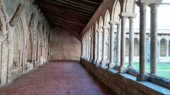 A Romanesque cloister outside the Elise Collegiale de Saint-Emilion church